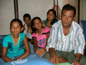 Sita (left) and her family at the IOM transit centre in Kathmandu. Sita is the 20,000th Bhutanese to be resettled in America.