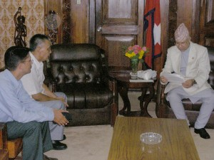 Nepalese PM reads the appeal of DNC. Dorji (middle) and Nepalese journalist Binod Dhungel in the DNC delegation/Vidhyapati